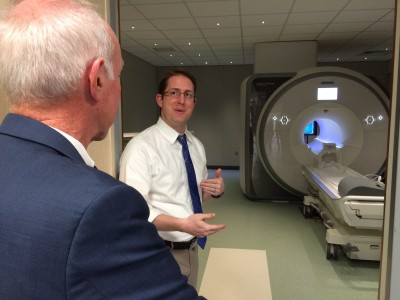 Pete Molfese explaining MRI and brain science to Congressman Joe Courtney